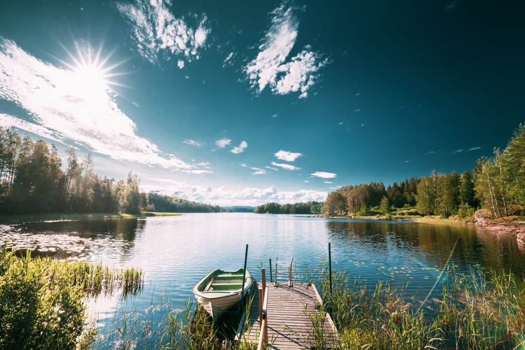 Old Wooden Fishing Boat Moored Near Pier In Summer Lake Or River. Beautiful Summer Sunny Day Or